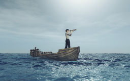 Man with spyglass Stock Photography