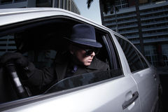 Man spying on someone from his car Royalty Free Stock Images