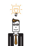 Man with square head. Man with a square head wearing black suit, yellow tie have a good idea Stock Photography