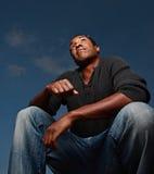 Man squatting forward Stock Photo