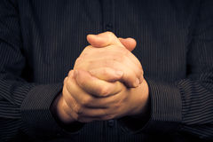Man squeezed his hands gesture victory Stock Image