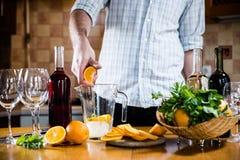 Man squeezes orange Stock Images