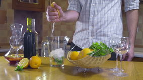 Man squeezing grapefruit for sangria slow motion stock video footage