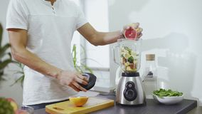 Man With Blender Cooking Smoothie At Home Kitchen Stock