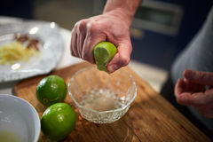 Man squeezing limes Royalty Free Stock Photo