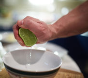Man squeezing limes Stock Images