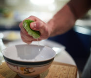Man squeezing limes Stock Image