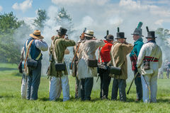 Man Squints during Firing of Muskets Stock Photography