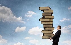 Man with stack of books in hands Royalty Free Stock Photo
