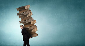 Man with stack of books in hands Royalty Free Stock Photography