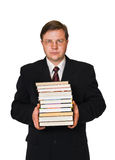 Man with stack of books. Isolated on white background Stock Photos
