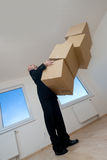 Man with stack of boxes Stock Images