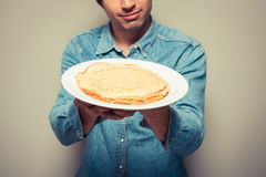 Man with stack of pancakes Stock Photography
