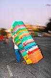Man with stacked market baskets in Bangkok Royalty Free Stock Photos