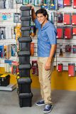Man With Stacked Toolboxes In Hardware Store Royalty Free Stock Photography