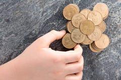 Man stacking American dollar coins Stock Photos