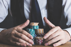 A man stacking chips on a table Stock Photo
