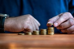 Man stacking money in Chart Stock Images
