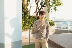 A man stading isolated and using phone royalty free stock image