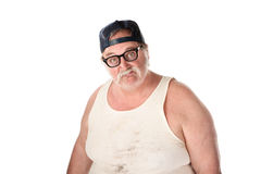 Man in stained shirt wearing baseball cap. Fat man in tee shirt on white background Stock Photos