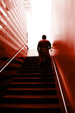Man on the stairs. Man climbing on the stairs Royalty Free Stock Images