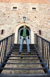 Man on the stairs. Brick wall Stock Photo