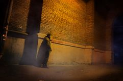 Free Man Stand Alone At The Foggy Street Under The Street Arch Of The Old House Stock Photos - 104504983