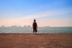 Man stand alone on the sea  beach at sunset haze Calm sea Royalty Free Stock Image