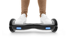 Man stand on black hover board isolated. Royalty Free Stock Image
