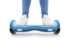 Man stand on blue hyro scooter isolated Royalty Free Stock Images