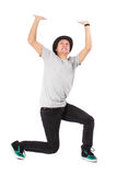 Man stand and expressing pressing up concept. Young attractive happy smile man stand and expressing pressing up concept, holding raised arms and hands up Royalty Free Stock Photo