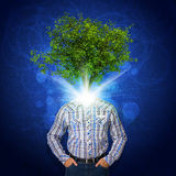 Man stand with green tree instead his head Stock Photo