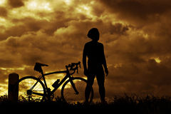 Man stand on Mountain bike silhouette in sunrise Royalty Free Stock Images