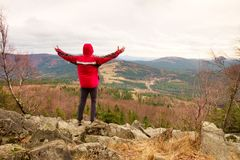 Man stand on a rock in a cold windy spring day. Active lifestyle, outdoor activities, hike Royalty Free Stock Photos
