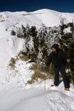 Man stand on snow mountain Royalty Free Stock Photos