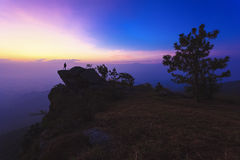 Man stand on the top of mountain at sunrise Royalty Free Stock Image