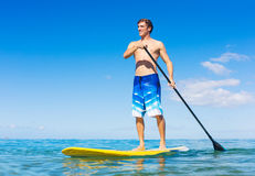 Man on Stand Up Paddle Board. Attractive Man on Stand Up Paddle Board, SUP, Tropical Blue Ocean, Hawaii Stock Image