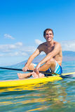 Man on Stand Up Paddle Board Stock Photos
