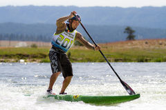 Man on a stand up paddle board Stock Image