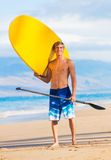 Man with Stand Up Paddle Board Stock Photo