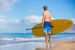 Man with Stand Up Paddle Board Stock Image