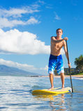 Man on Stand Up Paddle Board. Young Attractive Mann on Stand Up Paddle Board, SUP, in the Blue Waters off Hawaii, Active Life Concept Stock Photography