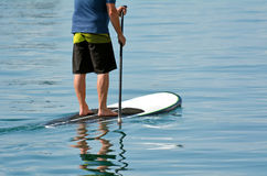 Man on stand up paddling Stock Photo