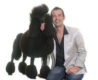 Man and standard black poodle Royalty Free Stock Images