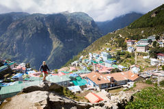 Man standing above mountain village. Stock Images
