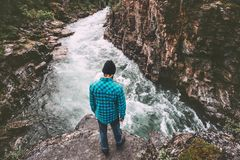 Man standing alone above river travel lifestyle royalty free stock photo