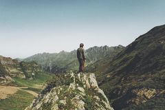 Man standing alone on cliff. Enjoying mountains view Travel Lifestyle motivation concept adventure vacations outdoor Royalty Free Stock Image