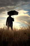 Man standing alone in the countryside Royalty Free Stock Photo