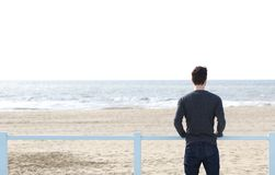 Man standing alone looking at sea Stock Photo