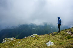 Man standing alone in the mountains Stock Photos